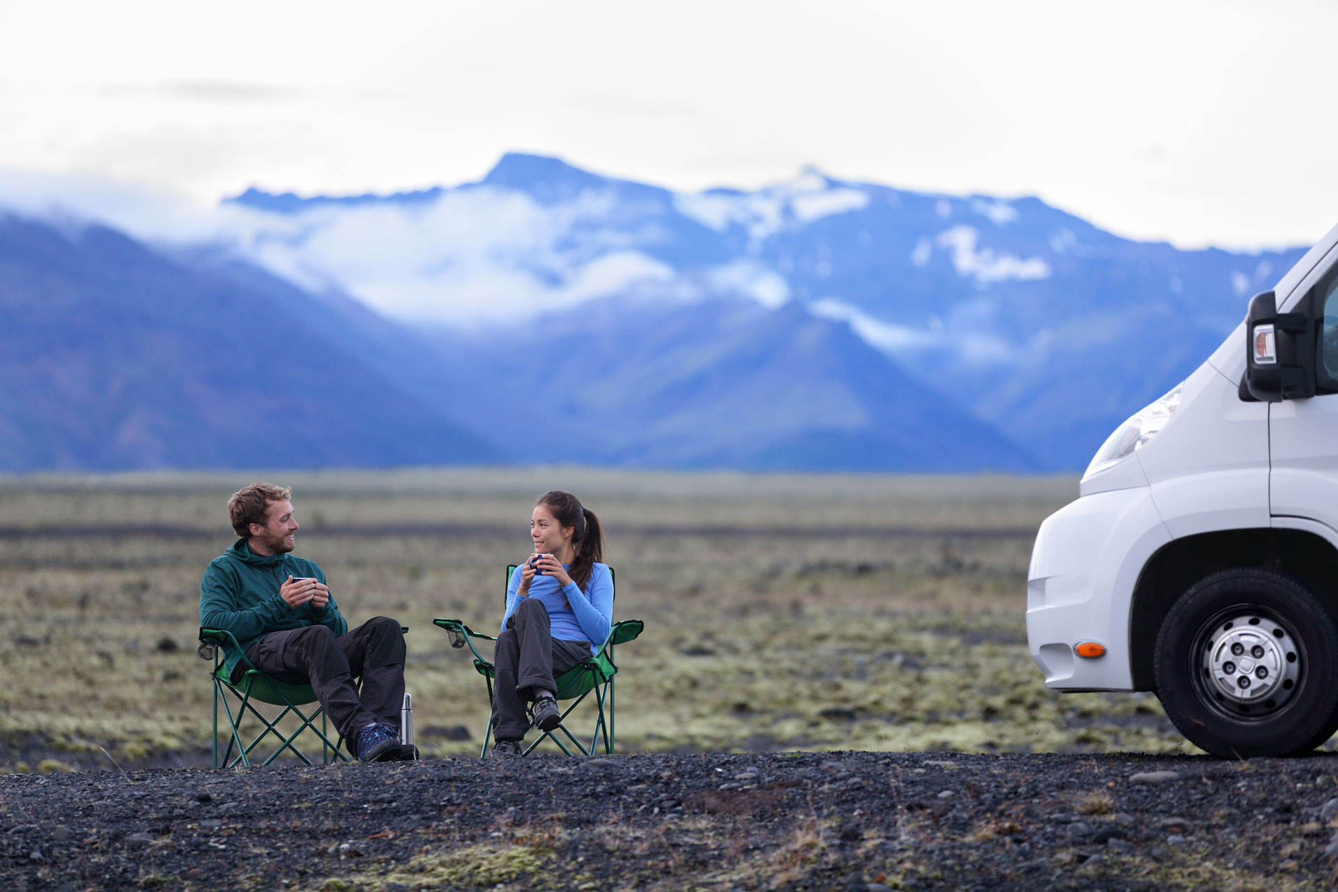 Overlanding couple in chairs