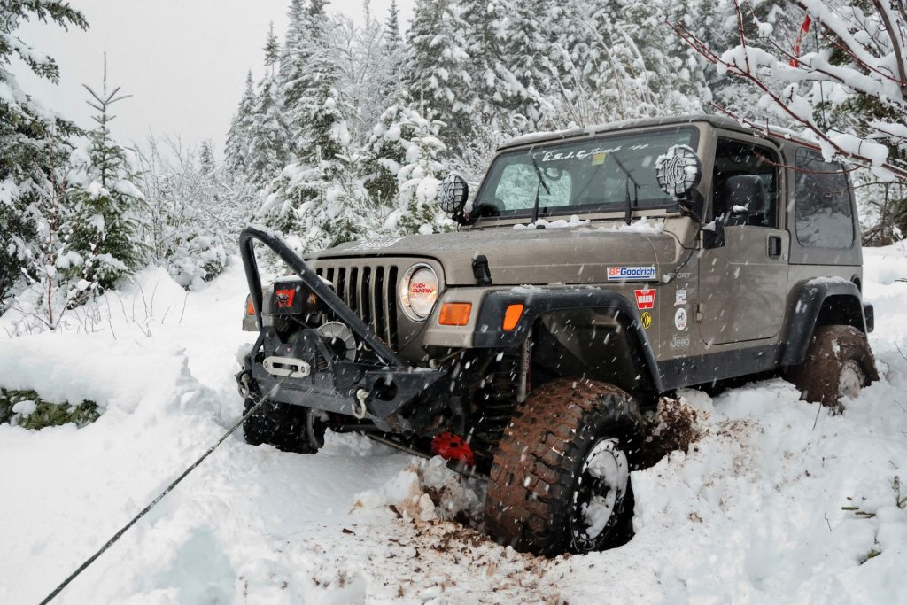 Jeep Using a Winch in Snow
